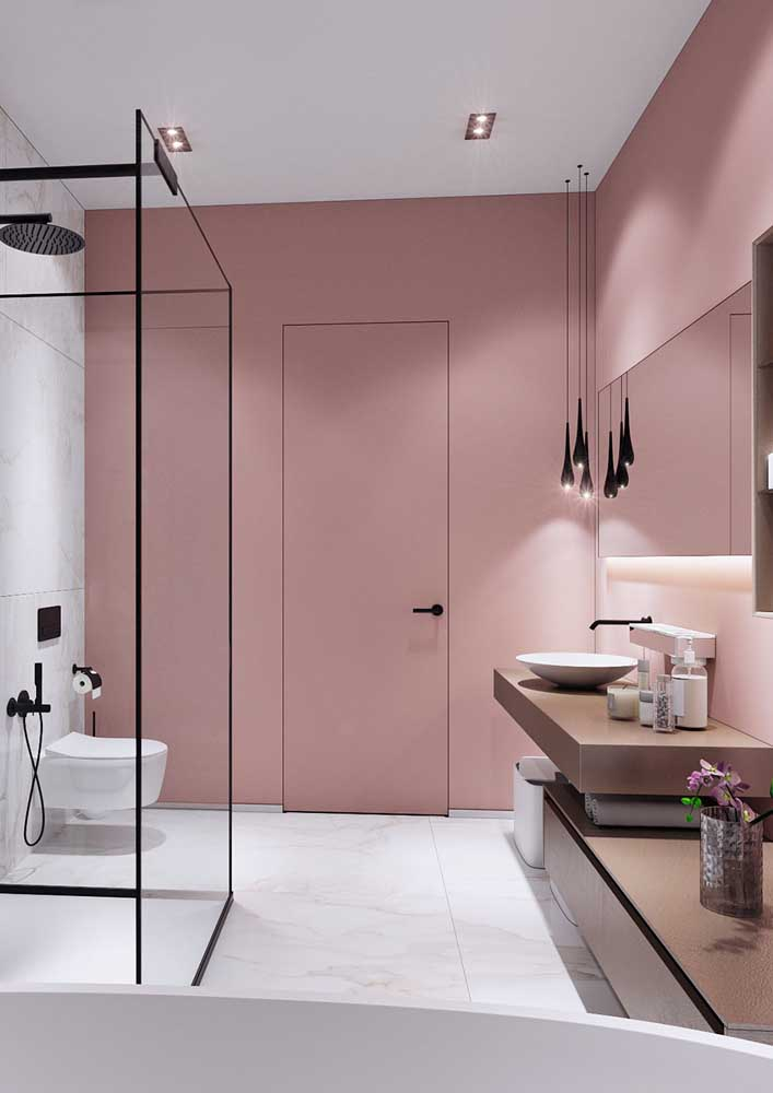 39. For the pink bathroom to be more modern, add black details.