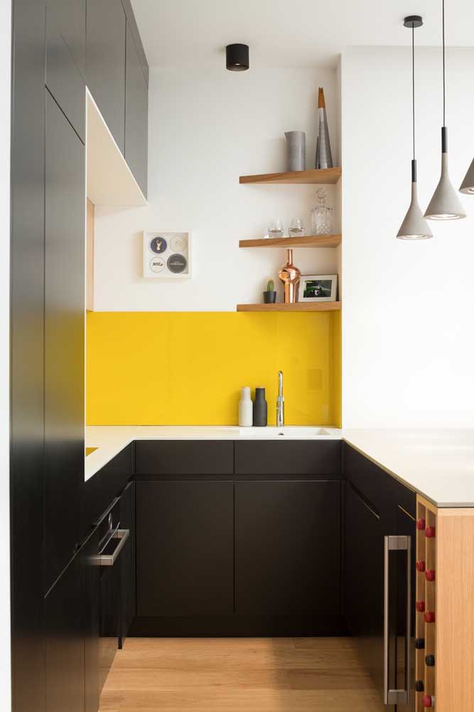 39. This small, planned American kitchen was perfect with the wooden angles and the yellow stripe on the wall to contrast with the black furniture.