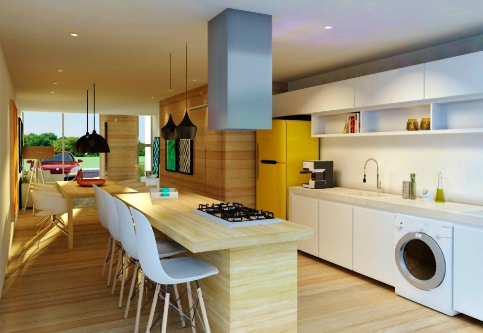 41. Kitchen with wooden island, cooktop and hood.