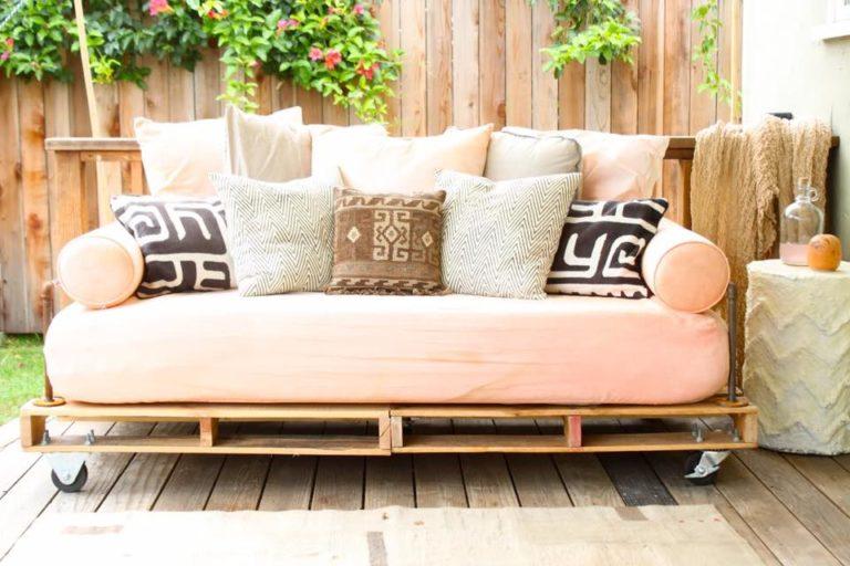 41. Make the sofa more feminine with salmon tones