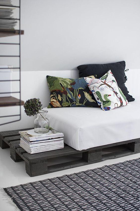 42. Simple pallet sofa with dark gray paint and white mattress