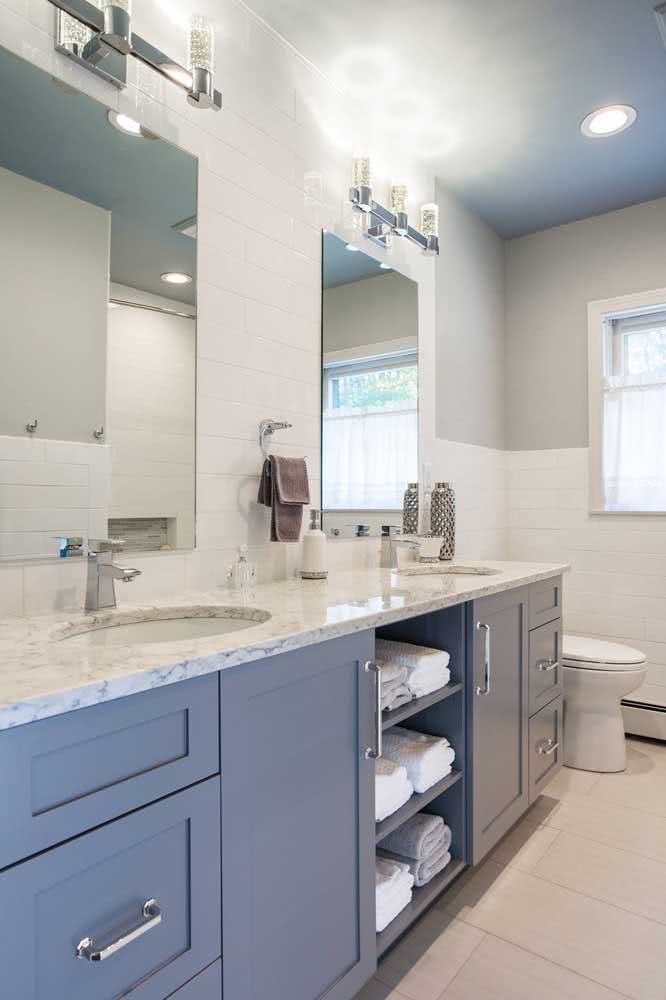 43 - White granite with blue cabinets.