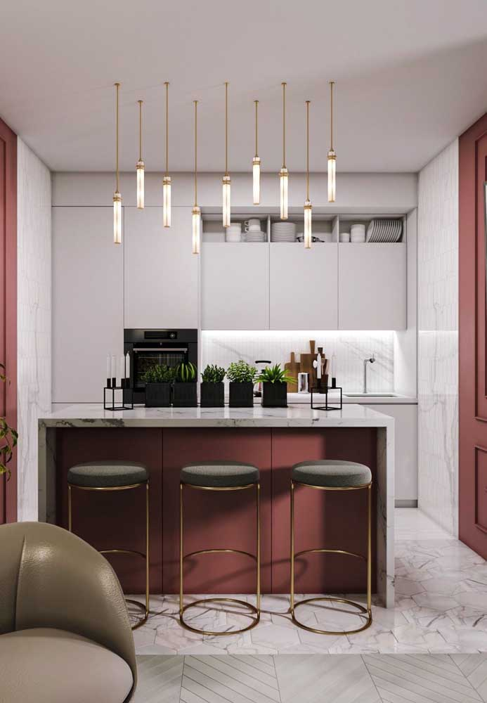 44. Small American kitchen in a contemporary style and original pendants under the marble counter.