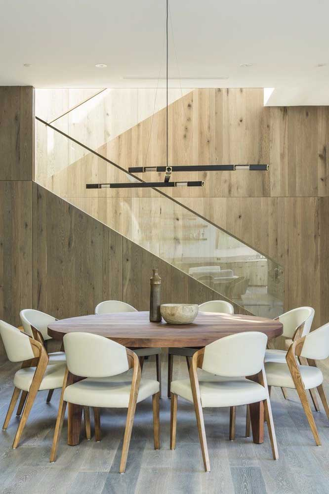 48. The oval table takes up less space and allows a larger number of chairs to be accommodated.