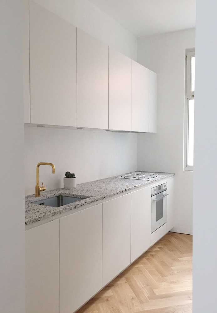 49 - Already here, the gray granite countertop in the kitchen was valued by the golden tap.