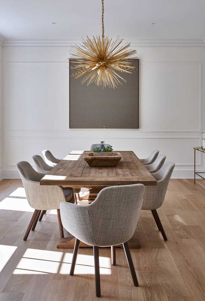 50. Demolition wooden table with chic upholstered chairs.