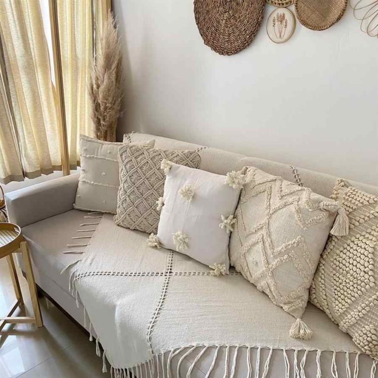 8 - Sofa decorated with blanket and cushions