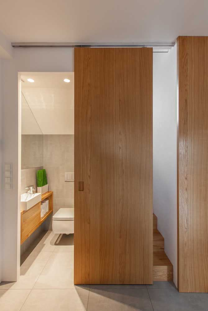 01 - Wooden sliding door to the bathroom. Charm and elegance covering the entire length of the wall.