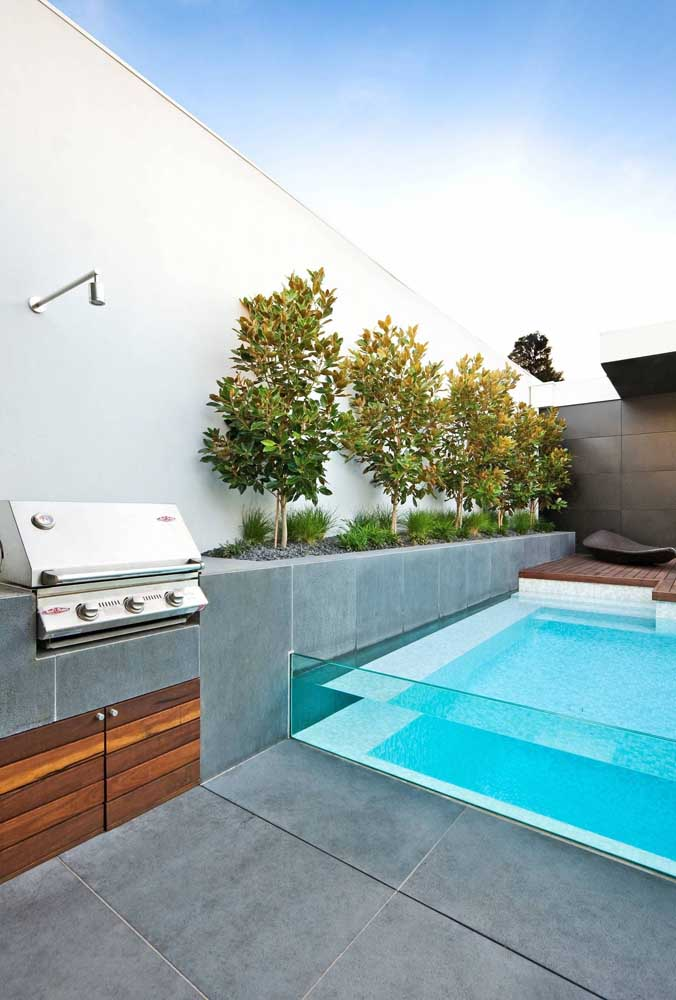 08. Leisure area with small and simple barbecue. The glass edge pool is the highlight of this project.