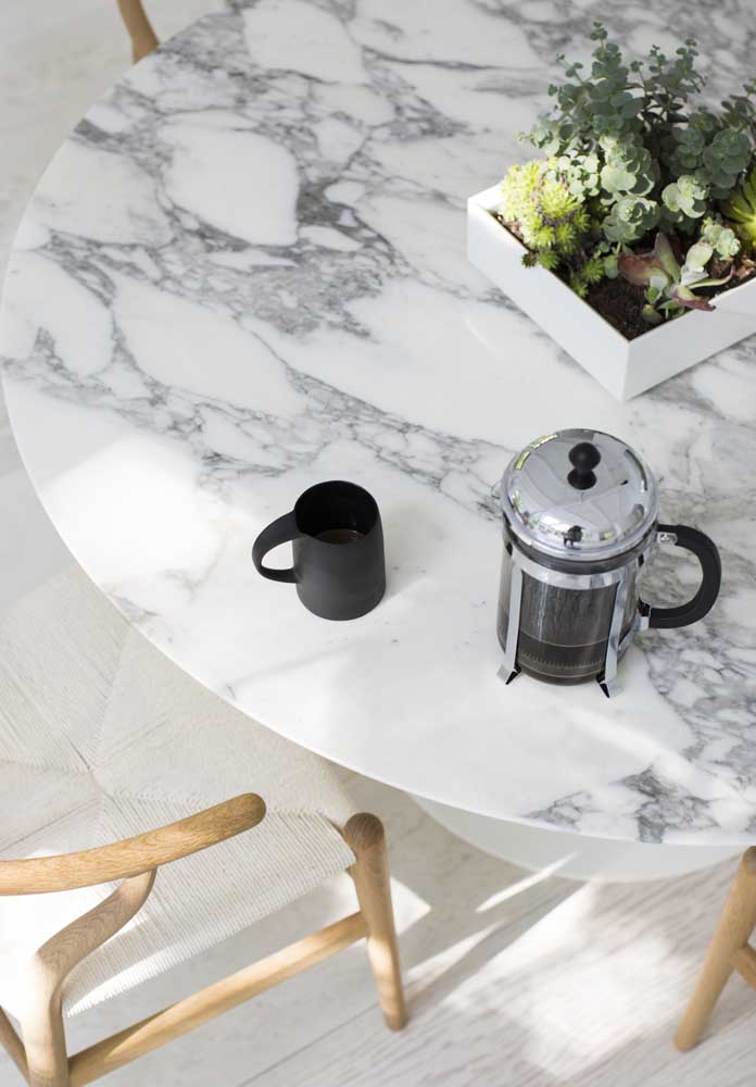 10. How about a table topped with white Carrara marble?