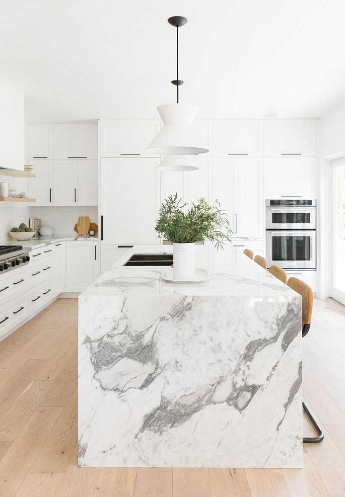 12. It's not just a kitchen island. It is an island made of Carrara marble.