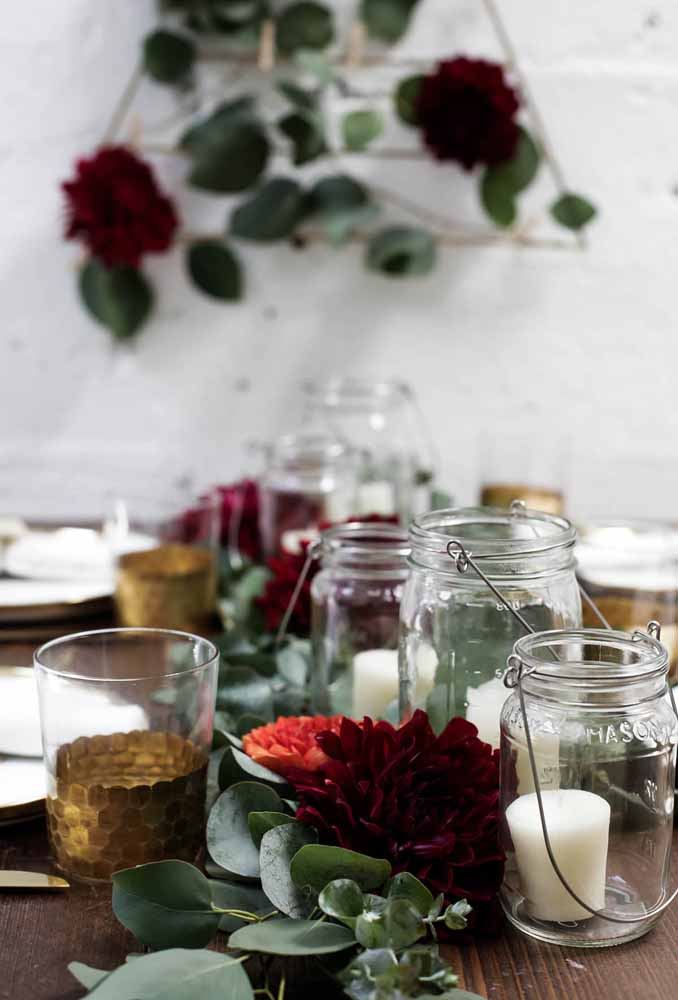 13. Use glass canisters to make candle holders