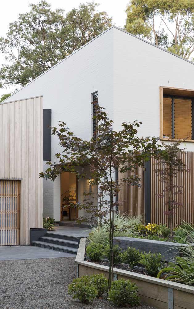 16. A contemporary facade with a stone garden at the entrance.