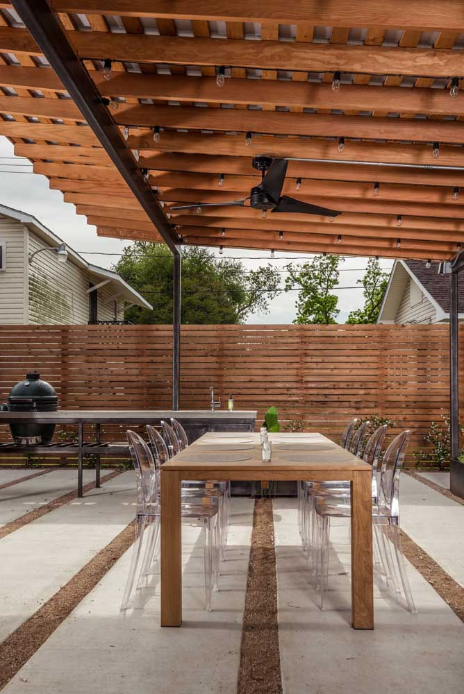 19. Recreation area with barbecue decorated in a mix of styles between modern and rustic.
