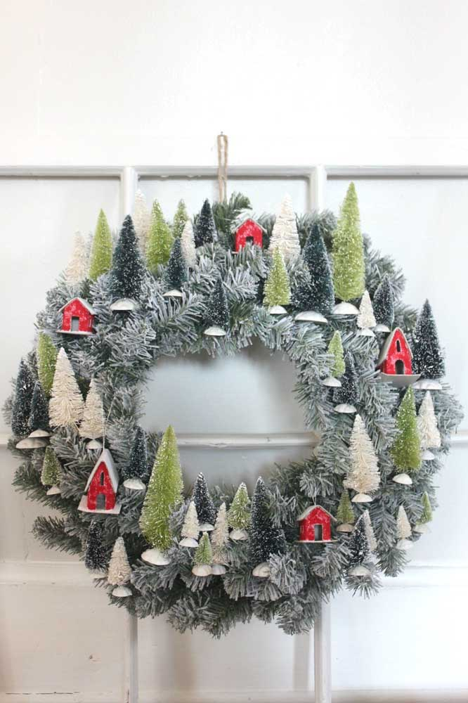 20. A snow-covered mini city depicted in the Christmas wreath.