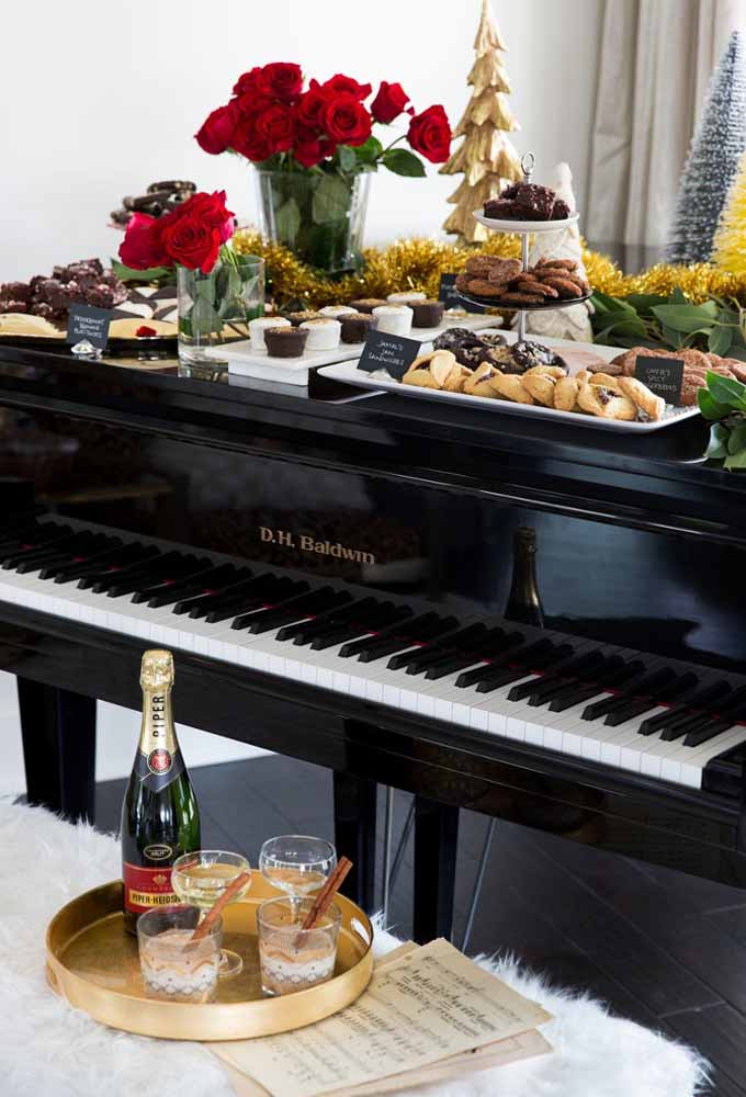 22. Use the piano bench to serve Christmas dinner snacks