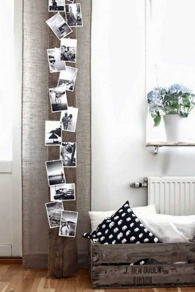 25. To match the more rustic decor, use a tree trunk to hang your photos.