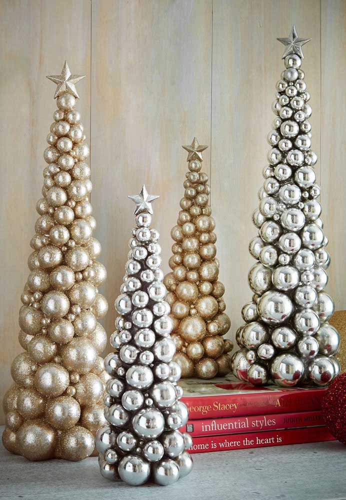28. How about making several mini trees with gold and silver Christmas baubles?