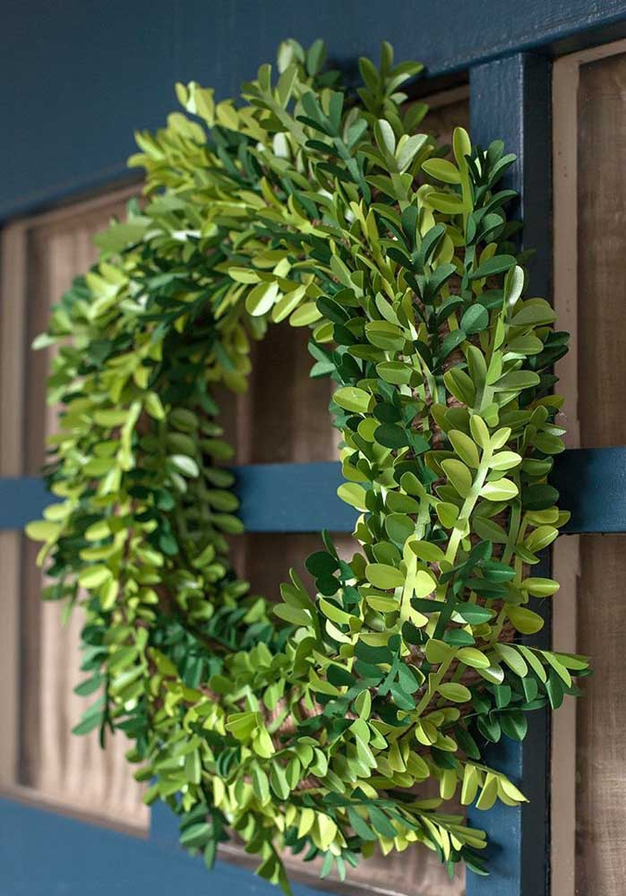 31. Wreath with branches of artificial leaves; an option to last for many Christmases.