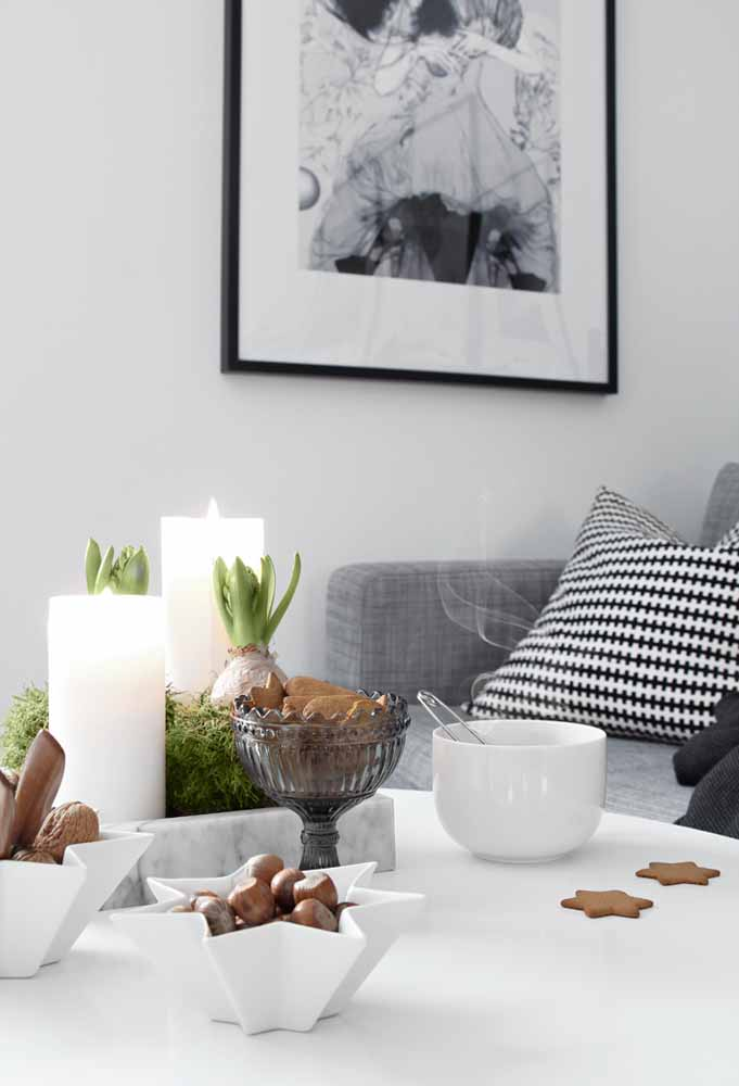 34. The candle adds a special touch to this coffee table