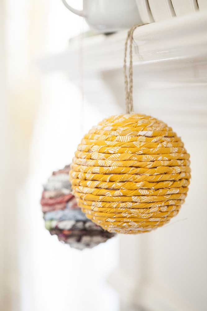 34. You can hang Christmas baubles in various corners of the house.