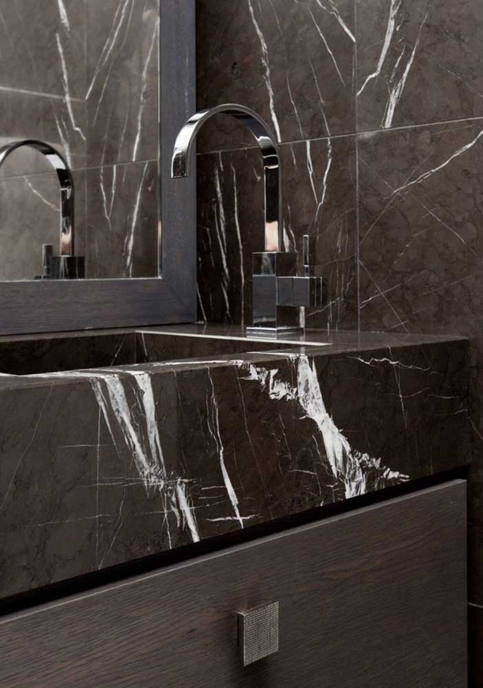 36. Brown marble on countertop and wall giving uniformity to the project.