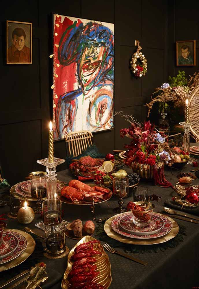 36. Golden Sousplat, Decorated Plate, Golden Candles and Red Colored Items Make a Luxurious Backdrop to Your Christmas Dinner