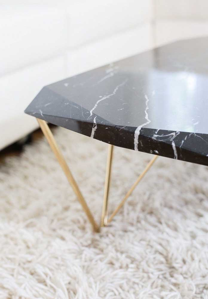 38. The charm of a coffee table with a nero marble top and gilded feet.