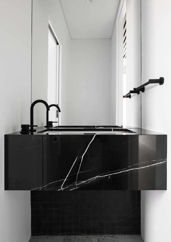39. White bathroom with Nero marble countertop.