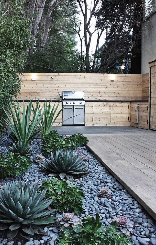 44. Around the wooden deck, a rock garden with cactuses and succulents.