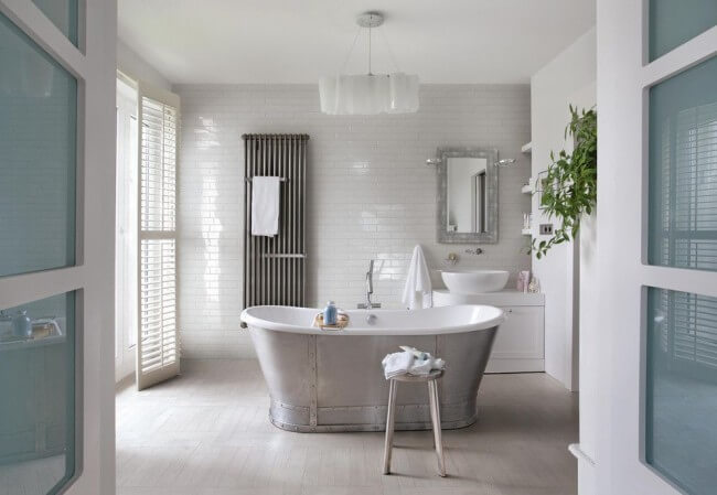 Cast iron bathtub with stainless steel trim