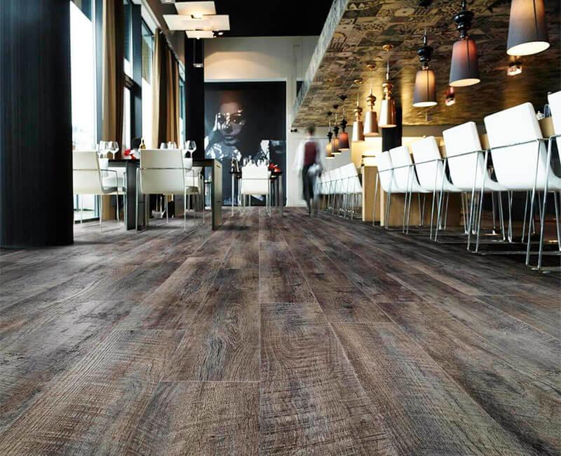 Quartz vinyl tiles with wood grain texture.